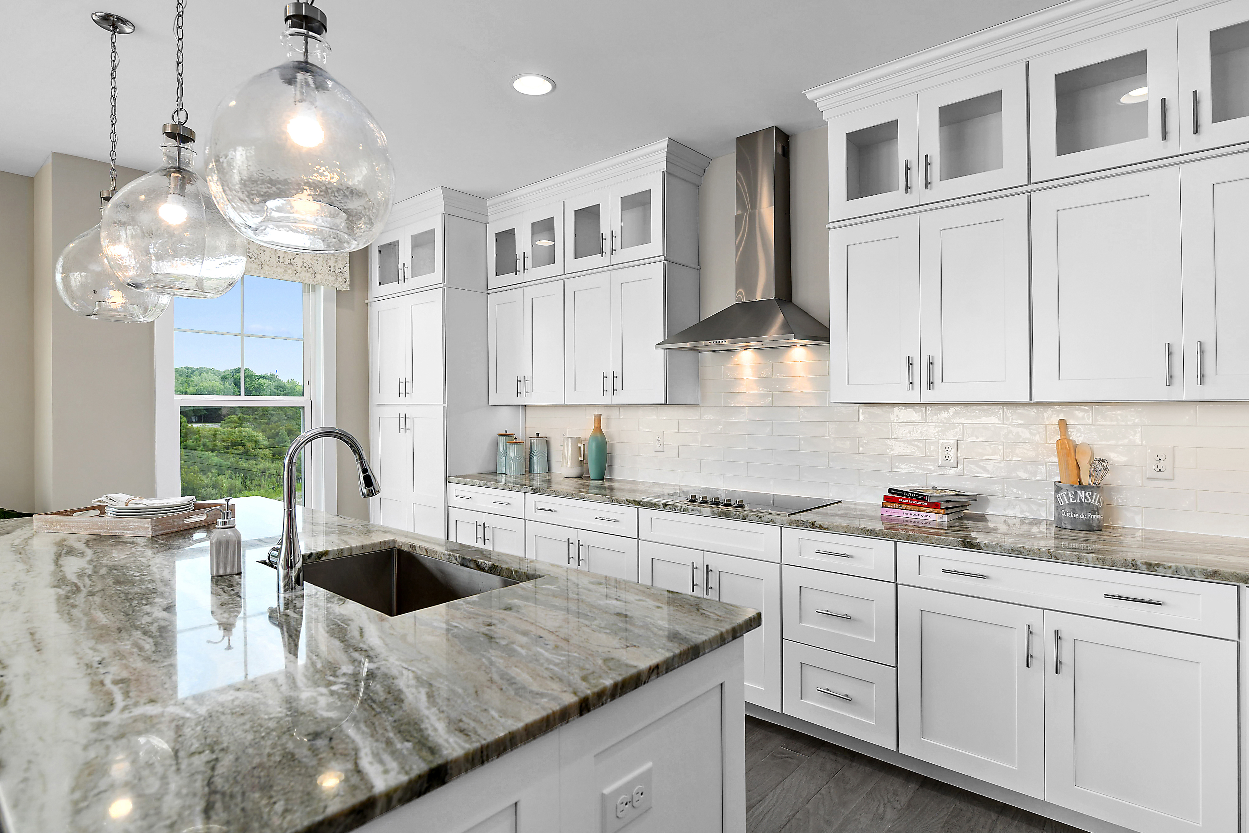 Gourmet Kitchen with White Cabinets, Glass Double Stacked Cabinets, Granite Counters, and Stainless Steel Appliances