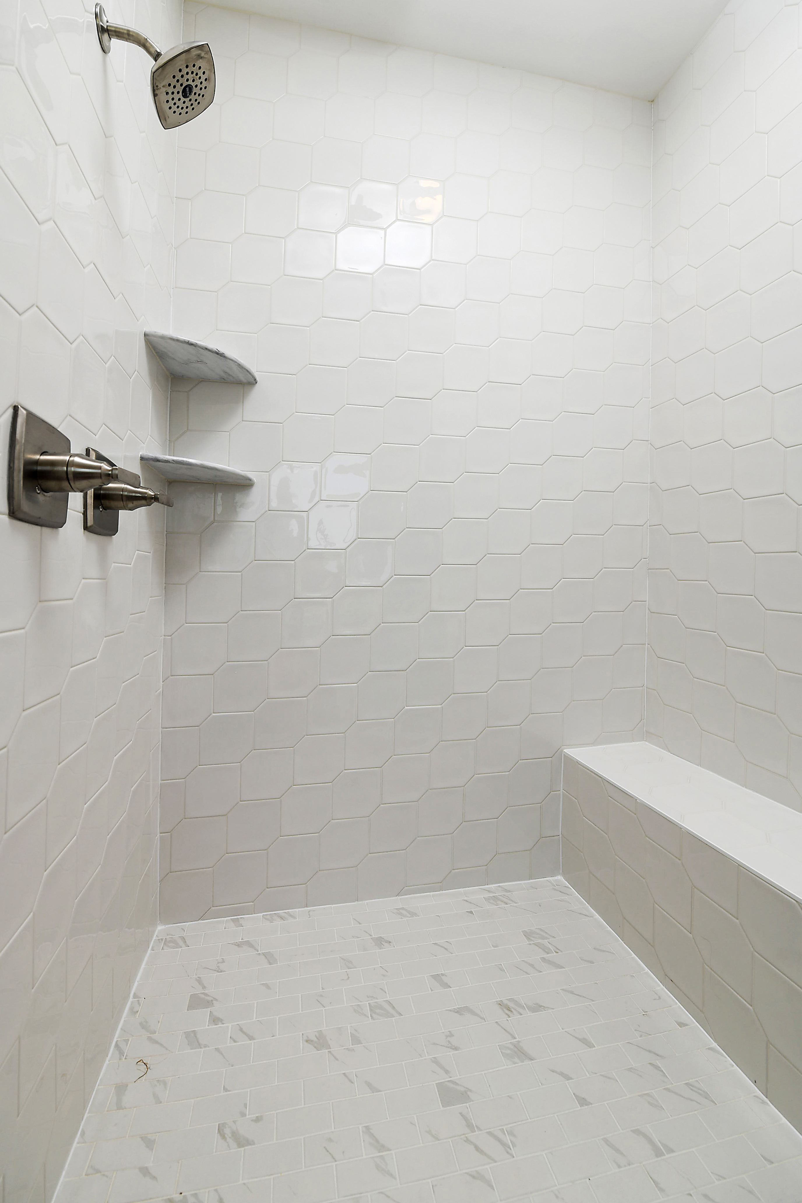 Owner Shower with White Tiled Wall and Shower Pan