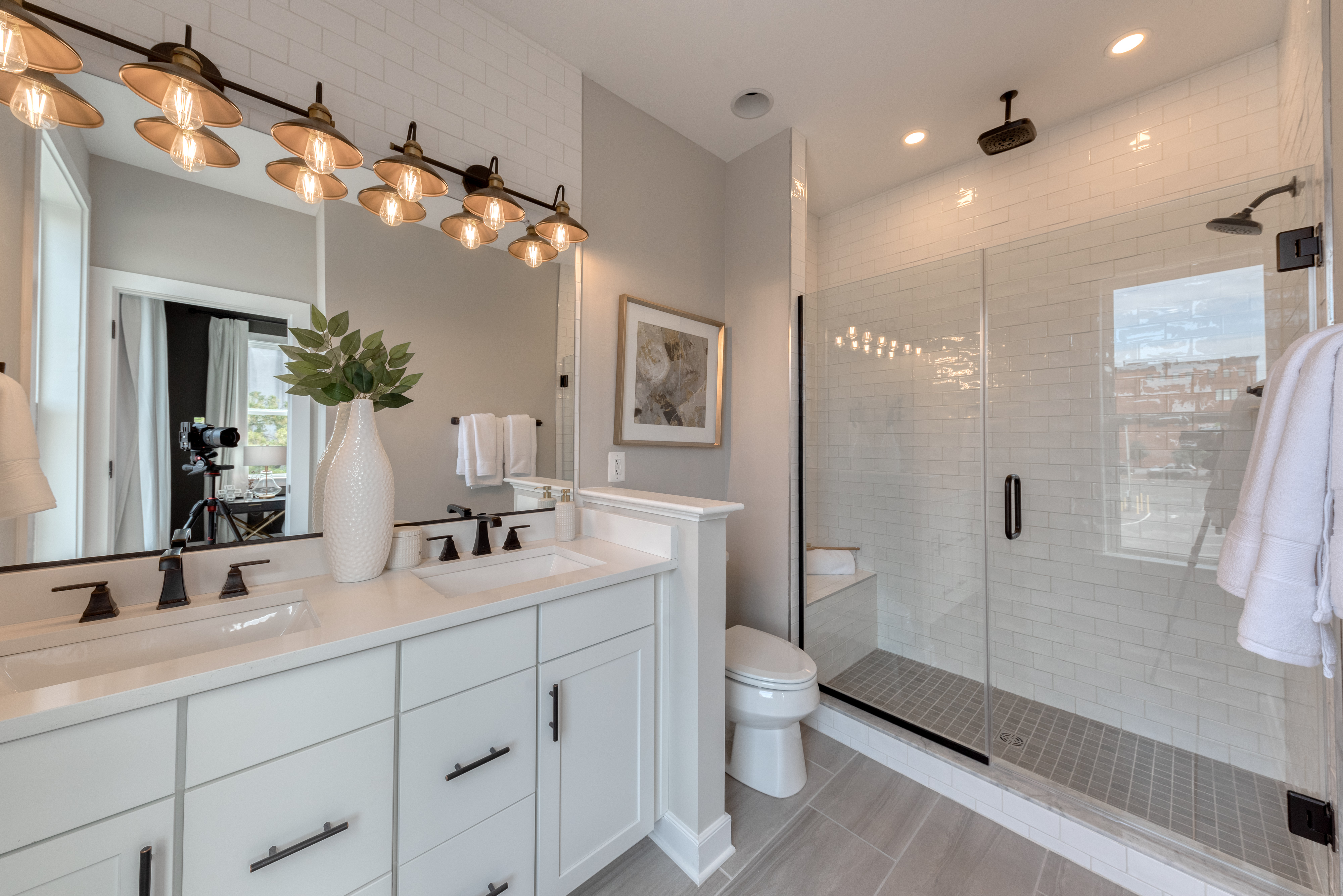 Second Owners Shower with Frameless Shower Door, White Tile, and Black Hardware