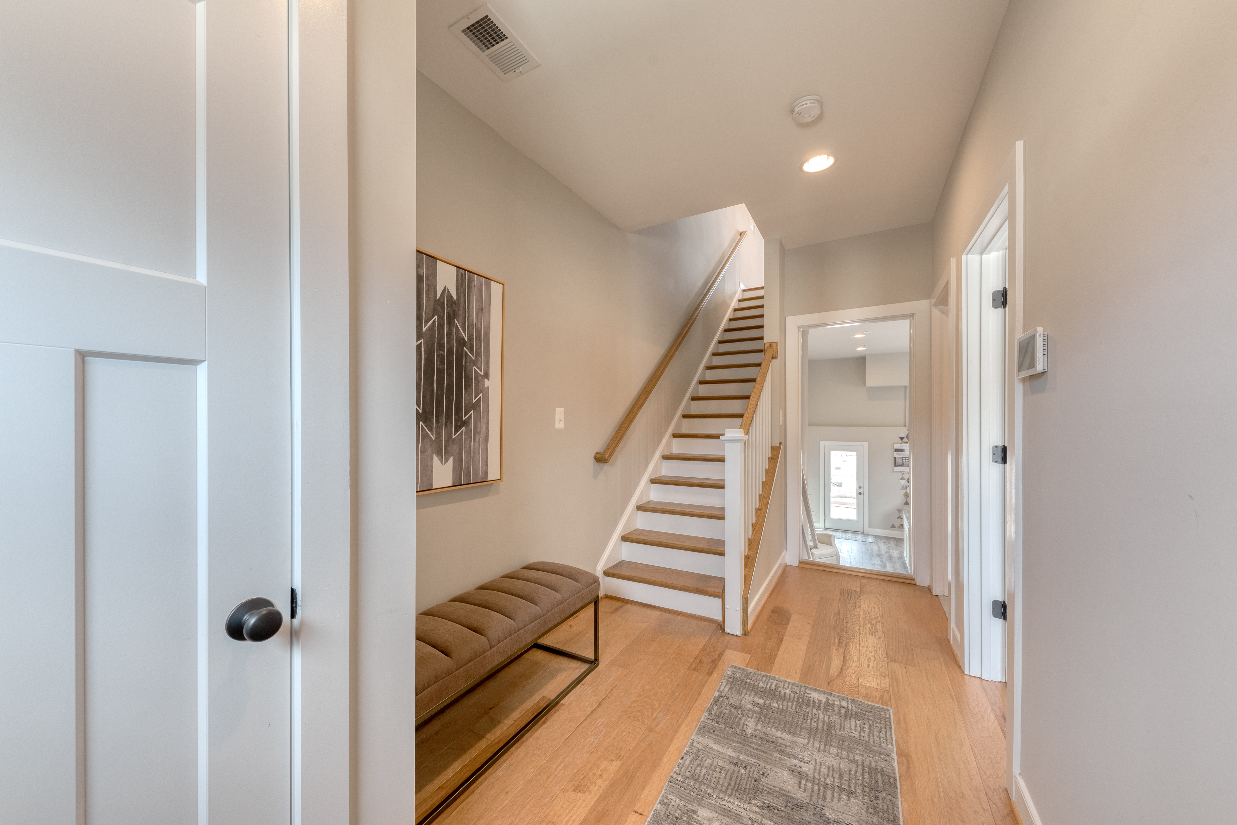 Entry View to Stairs and Garage Entrance Door