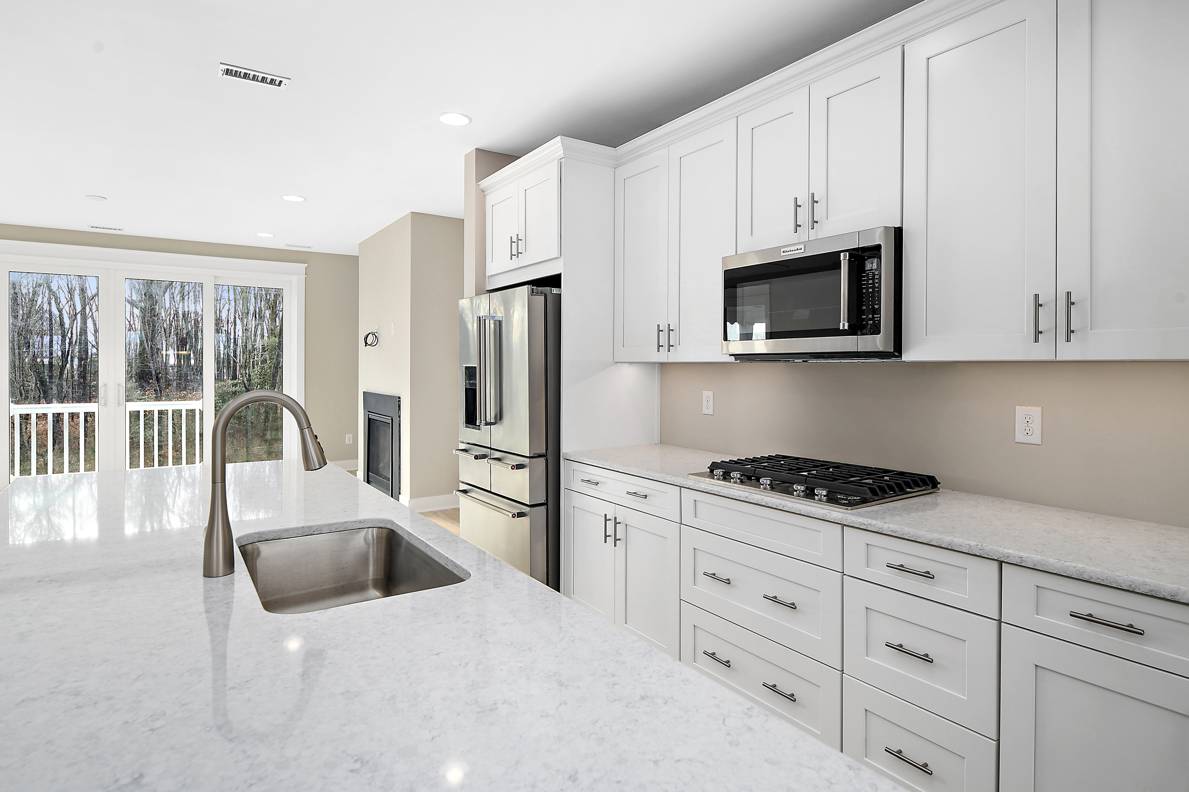 Gourmet Kitchen White Cabinets, Quartz Counters, and Stainless Steel Appliances
