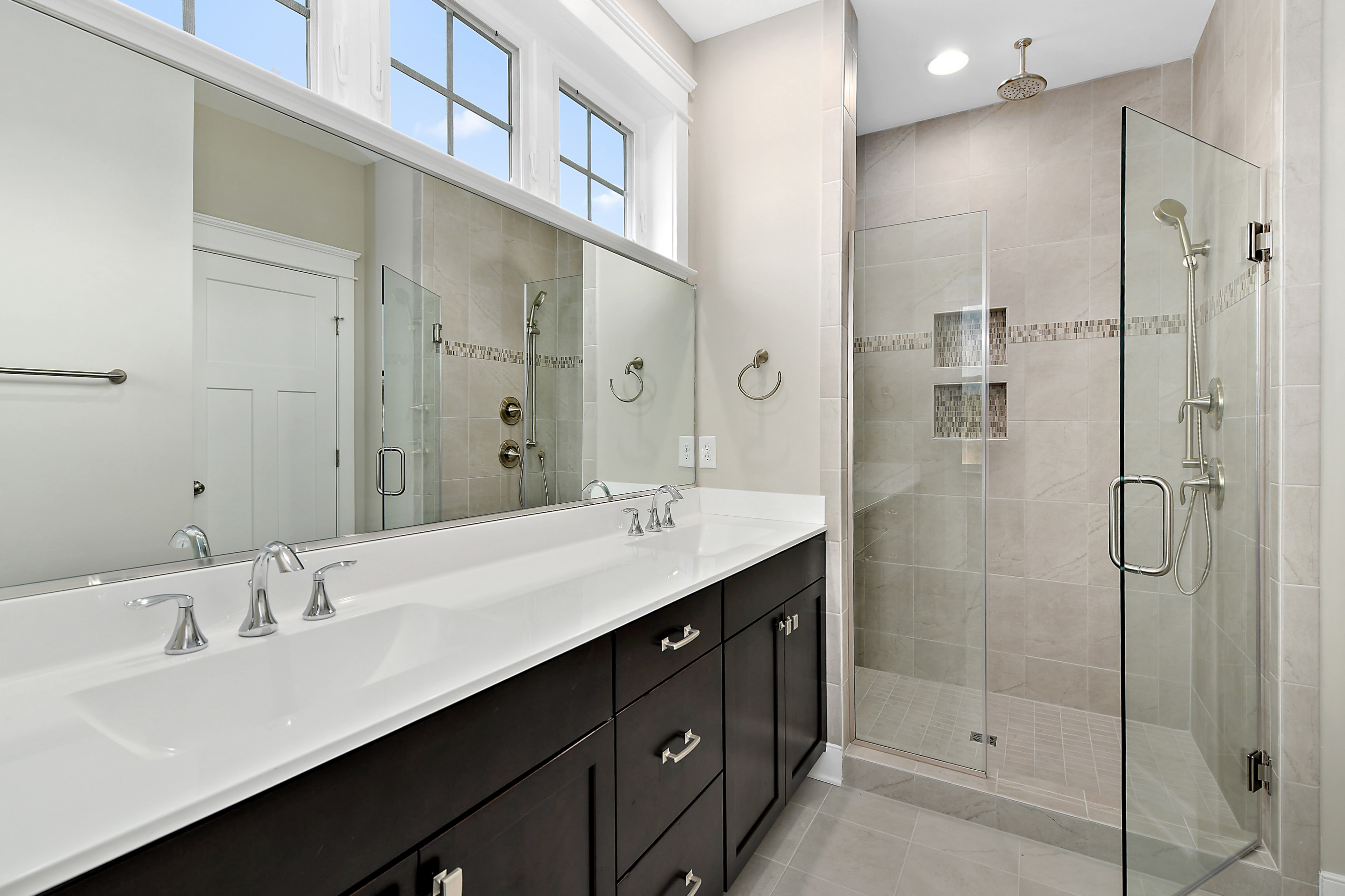 Owner Bathroom Double Vanity and Frameless Shower Door