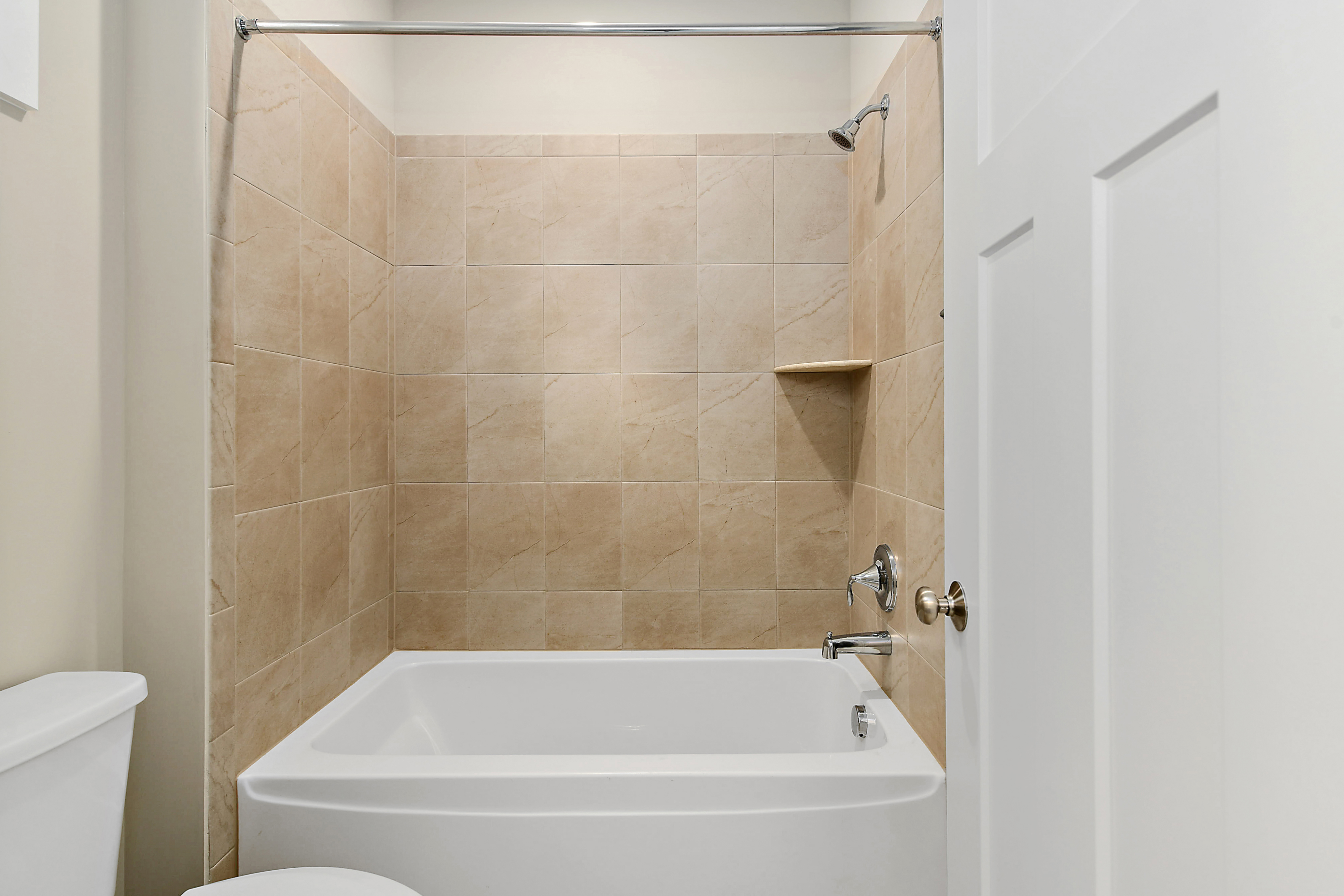 Hall Bathroom with Tub and Tile