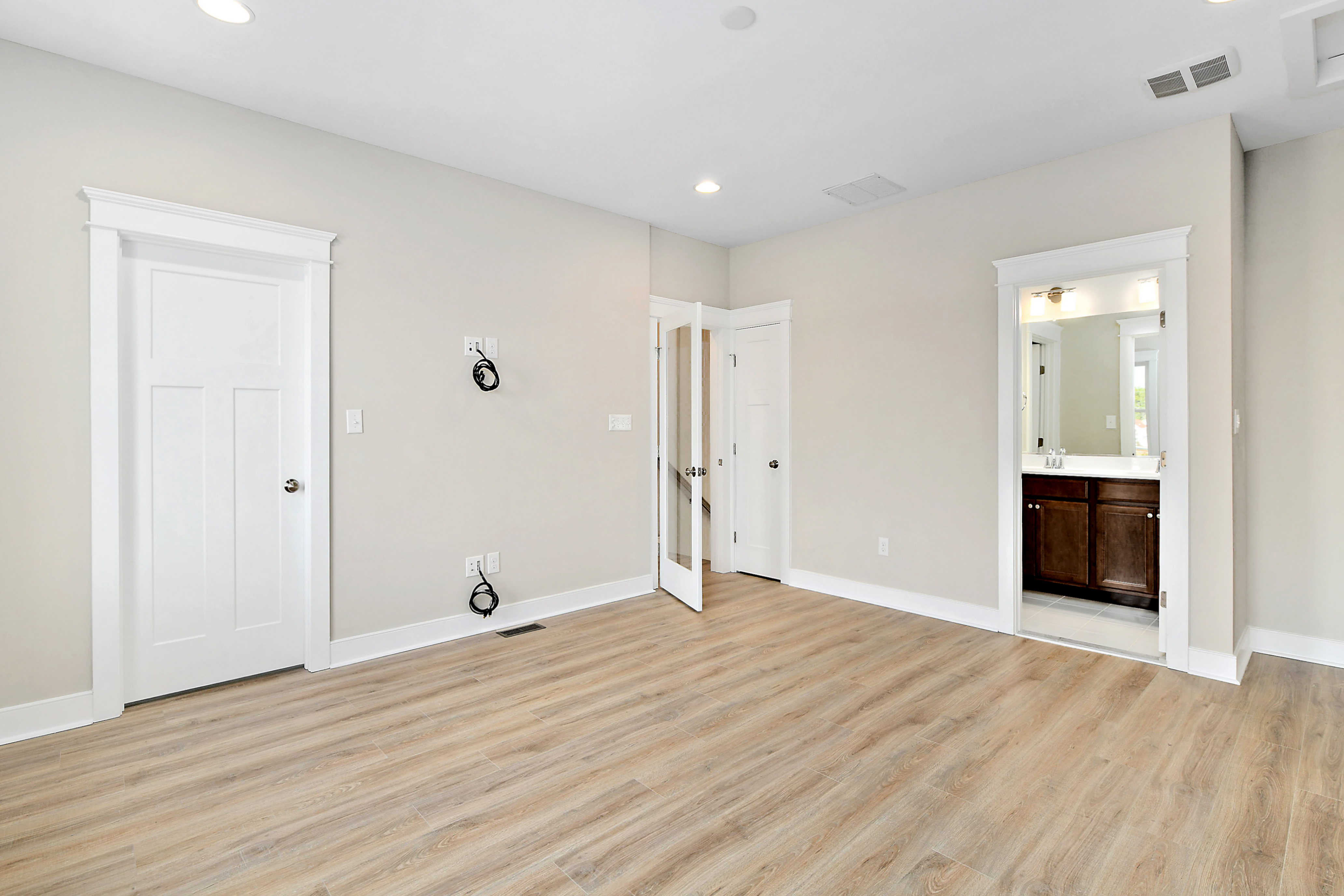 Guest Room Unfurnished with Wood Floors