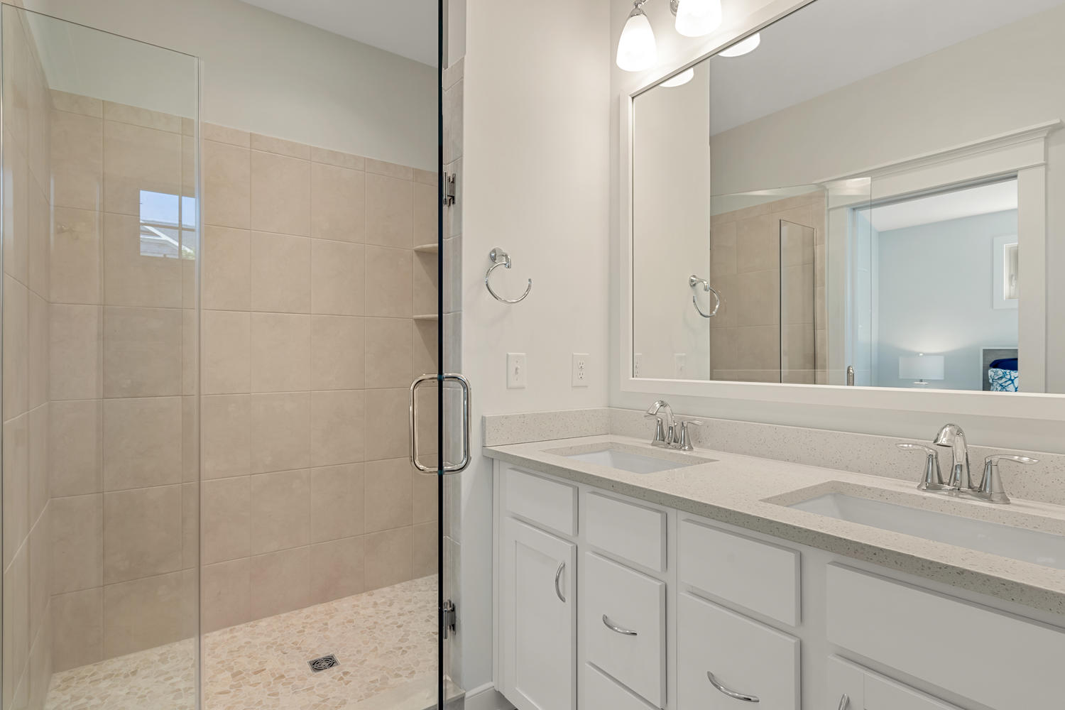 Guest Bath with Double Vanity Sink and White Cabinets