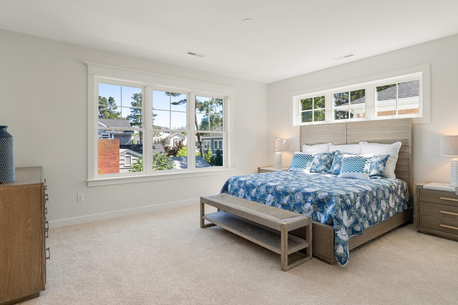 Staged Guest Bedroom with Large Bed, Dresser and Bench