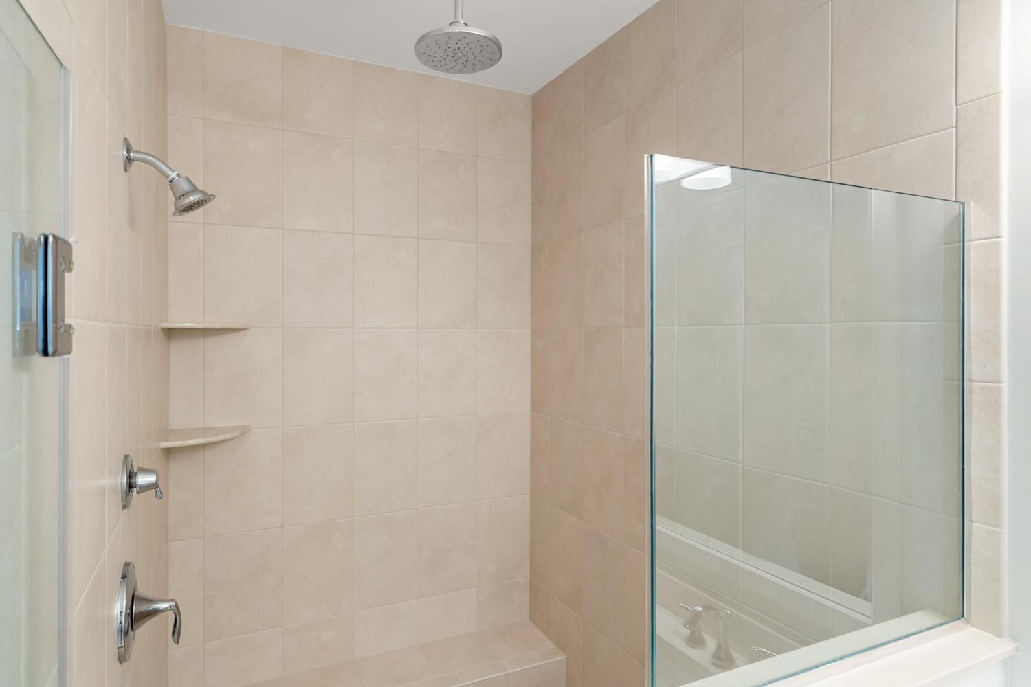 Owners Shower with Ceramic Tile and Frameless Shower Door