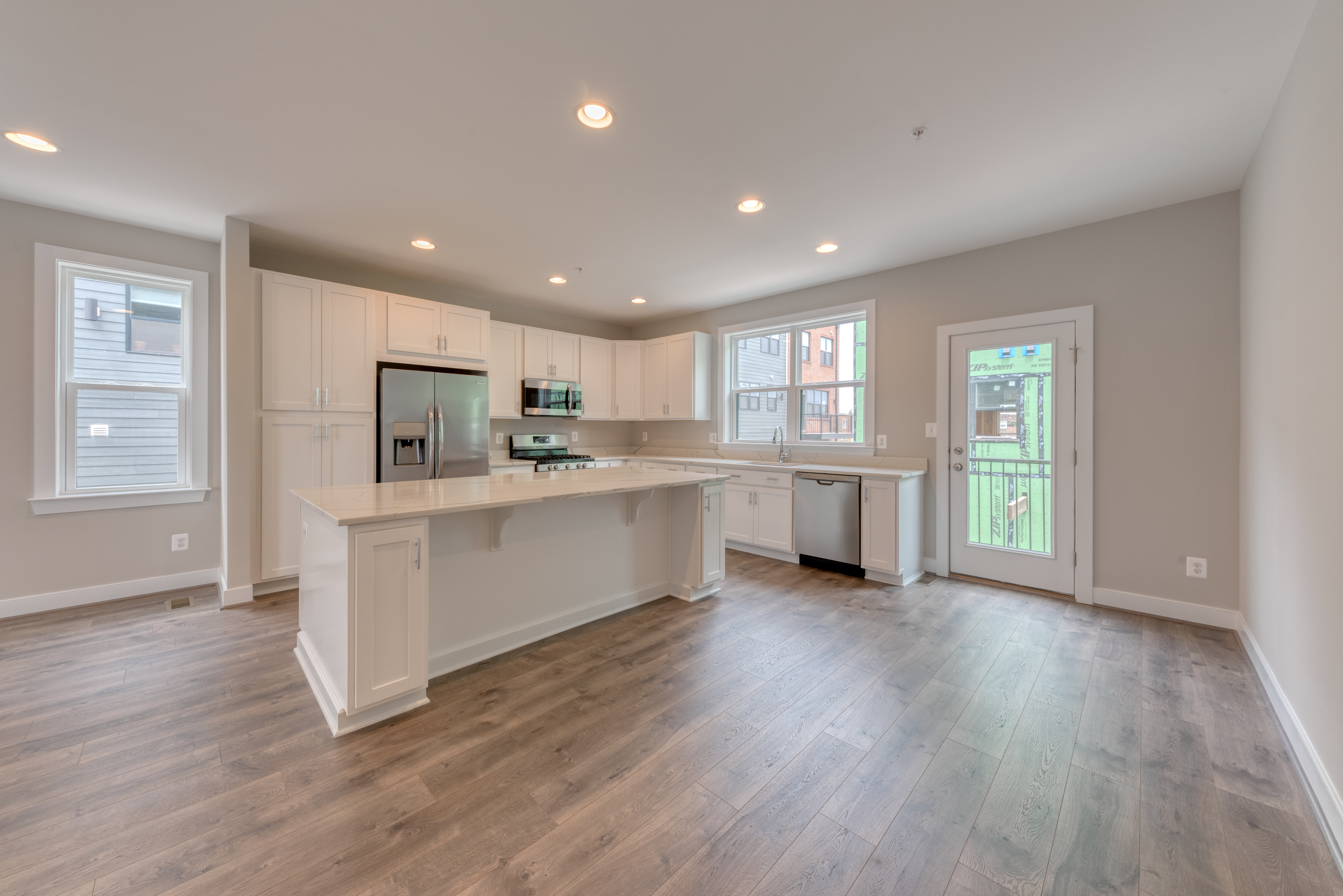 White Kitchen Cabinet Quartz Counters and Stainless Steel Appliances