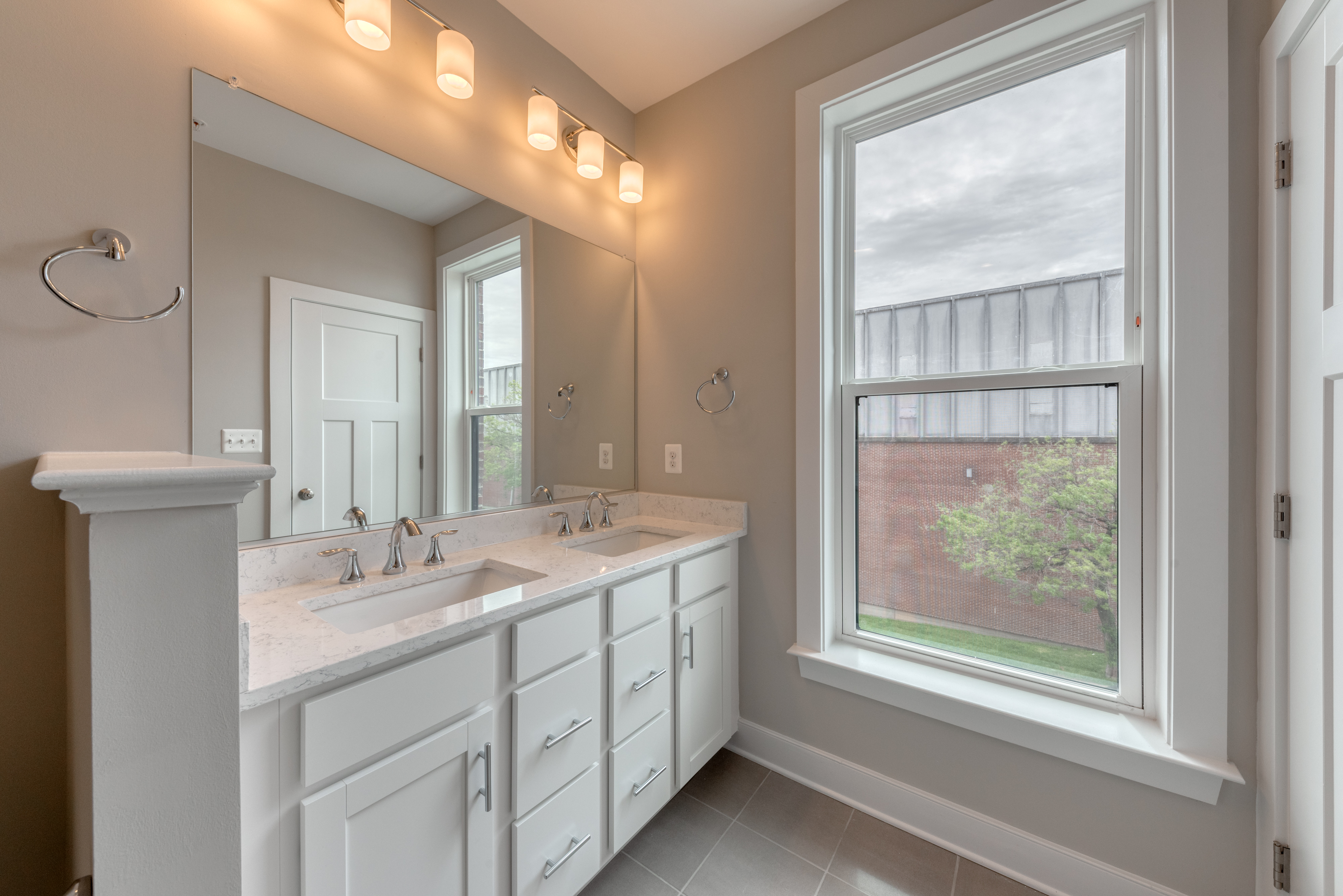 Bathroom with double vanity, window and lights